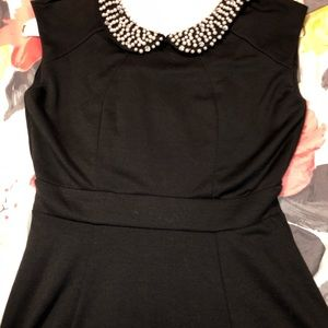 Small little black dress with pearl collar